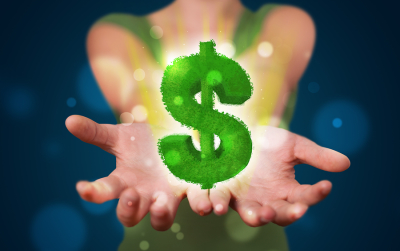 Young beautiful woman presenting green glowing dollar sign
